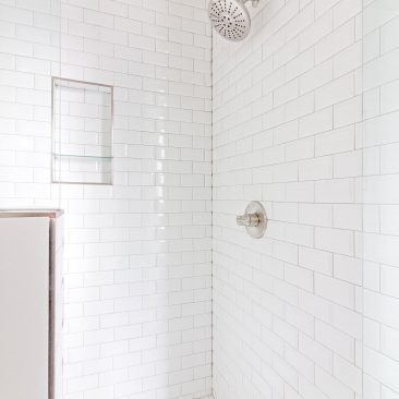 Bathroom Remodel with white hex tiled shower floor and subway tile