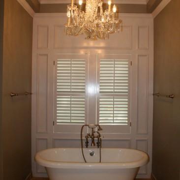 Bathroom remodel with dramatic bathtub and chandelier