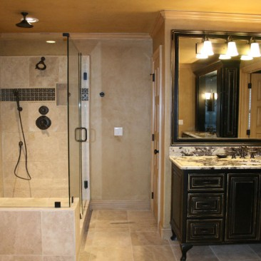 Bathroom Remodel with black cabinets, glass enclosed shower