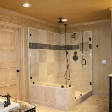 Bathroom Remodel Full Glass Shower with Tile and Black Cabinets