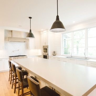Open Kitchen Remodel with large island with pendant lights