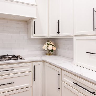Kitchen Remodel with white cabinets and subway tile