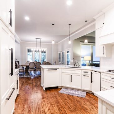Kitchen Remodel with white cabinets and wood floors