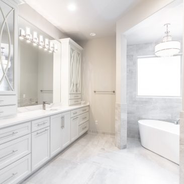Master Bathroom Home Remodel - luxury tub, white cabinetry