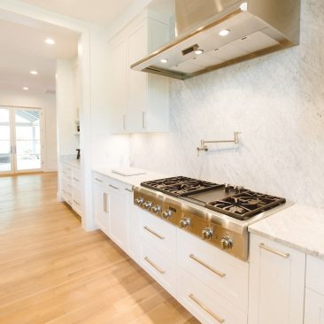 Open Kitchen Remodel with stainless steel range hood