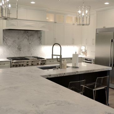 Kitchen remodel island with gray painted cabinets with white kitchen cabinets