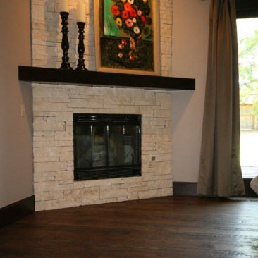 Master bedroom with fireplace and wood floors