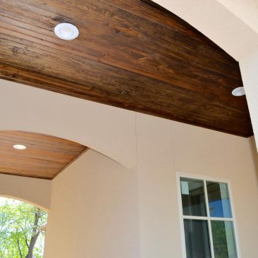Breezeway with tongue in groove wood ceiling.