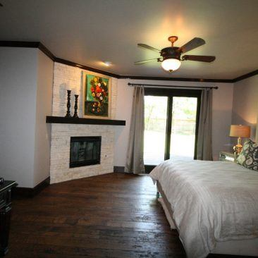 Master Bedroom with French doors, fireplace and wood floors