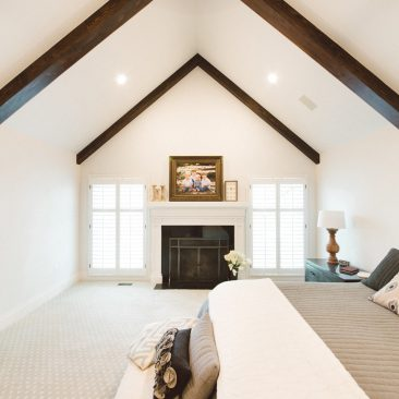 Master bedroom remodel with exposed beams, fireplace, neutral colors