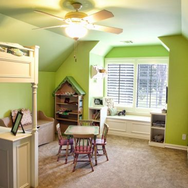 Kids Bedroom Remodel with green walls and window seat