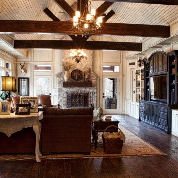 Living Room Remodel with exposed beams, wood floor, built in bookcases