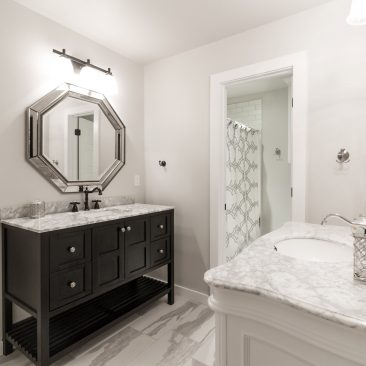 Custom bathroom for 2 - contrasting black and white vanities