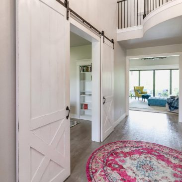 New Custom Build Home - white sliding barn doors and hand scraped & distressed hardwood floors