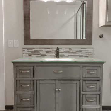 New Construction - Bathroom - gray vanity with glass tile