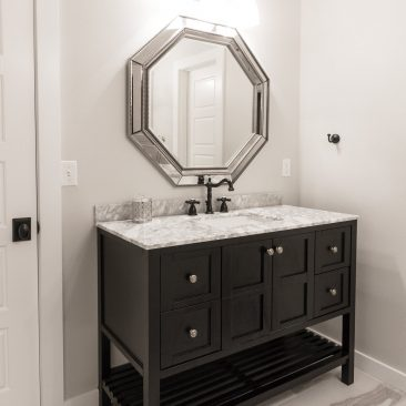 Custom bathroom - Black vanity with marble top