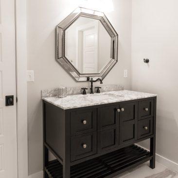 Custom bathroom - Black vanity with marble top