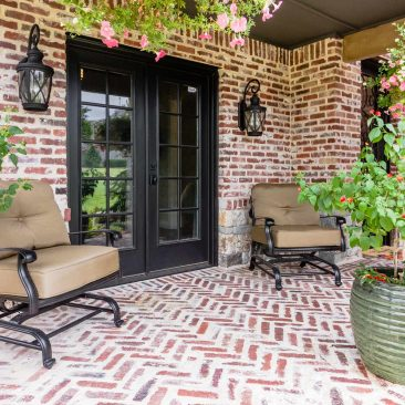 New Custom Home - Herringbone brick front patio with black frame French doors