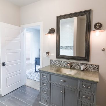 New Home - Guest Bath with gray tile and cabinet