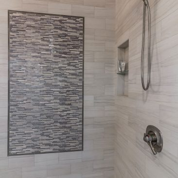 Master shower with metallic accent tiles