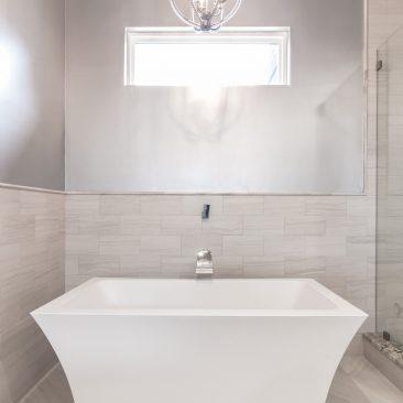 Master Bath freestanding tub with metallic wall