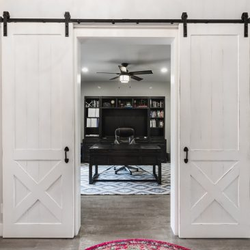 Custom Home office with white barn doors