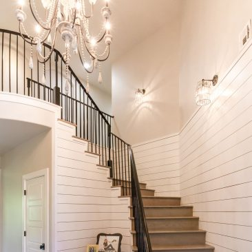 New Home Entry with stair, white shiplap, & chandelier