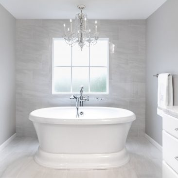 Master Bathroom - Home Addition - freestanding tub with chandelier and gray tile